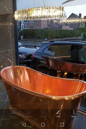 Kichler Crystal Skye chandelier and and amazing copper bath at Mizu Bathroom Design, Altrincham, Cheshire